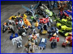 Large Bundle Of Transformer Action Figures Some Complete Some Old Some Broken